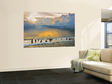 Indian Bathers Playing in Surf During Cloudy Sunset Wall Mural by Tim Makins