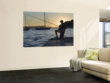 Man Fishing at Sunset at Port Wall Mural by Will Salter