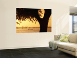 Silhouetted Tree with Fisherman in Canoe on Lake in Background Wall Mural by Frans Lemmens