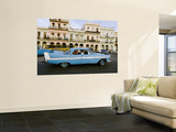 Classic 1950's Car Driving Through Downtown Wall Mural by Christian Aslund