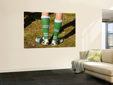 Football Boots with Legs in Them Wall Mural by Oliver Strewe