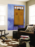 Yellow Doorway in a Blue-Painted House Wall Mural by Tim Hughes