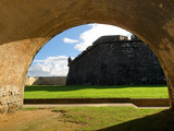Walls of El Morro Fort Viewed Through an Arch Photographic Print by George Oze