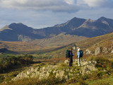 North Wales, Snowdonia; a Man and Woman Stop to Look at their Map Whilst Hiking in Snowdonia; Photographic Print by John Warburton-lee