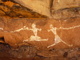 Libya, Fezzan, Jebel Akakus; a Pair of Running Figures Painted onto the Walls of Uan Muhuggiag Photographic Print by Amar Grover