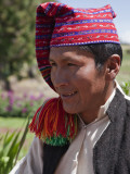 Peru, a Quechua-Speaking Man on Taquile Island Wearing Traditional Dress Photographic Print by Nigel Pavitt