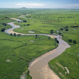 The Garamba River Winds Through the Grasslands of the Garamba National Park in Northern Congo Photographic Print by Nigel Pavitt