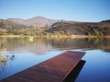 Fishing Boat on Lake and Drakensberg Mountains, Ukhahlamba-Drakensberg Park, Kwazulu-Natal Photographic Print by Ian Trower