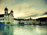 Switzerland, Lucern (Luzern), Jesuit Church and River Reuss Photographic Print by Michele Falzone