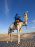 Tunisia, Sahara Desert, Douz, Great Dune, Rider and Camel Photographic Print by Walter Bibikow