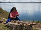 Peru, a Quechua-Speaking Woman Works Her Traditional Wooden Loom on Taquile Island Photographic Print by Nigel Pavitt