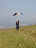 England, Isle of Wight; Boy Flying a Kite on the Downs Near Compton Bay in Southwest of the Island Fotografisk tryk af Will Gray