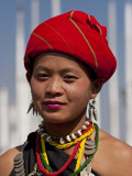 Myanmar, Burma, Loikaw; a Kayah Girl in Front of Ceremonial Posts at Chitkel Village Photographic Print by Katie Garrod