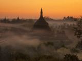 Myanmar, Burma, Mrauk U; Mist and Smoke from Village Cooking Fires Swirl around Ratanabon Paya Photographic Print by Katie Garrod