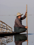 Myanmar, Inle Lake; Intha Fisherman Gently Paddling His Boat across Inle Lake, Myanmar Photographic Print by Katie Garrod