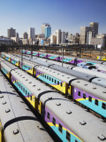 Train Carriages at Park Station with City Skyline in Background, Johannesburg Photographic Print by Ian Trower