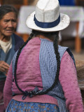 Peru; an Indian Woman with Long Pigtails at Pisac's Busy Sunday Market Photographic Print by Nigel Pavitt