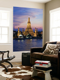 Thailand, Bangkok, Wat Arun ,Temple of the Dawn and Chao Phraya River Illuminated at Sunset Wall Mural by Gavin Hellier