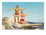 Couple de surfeurs Posters