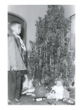 Boy Sticking out Lower Lip at Christmas Tree Posters