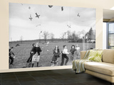 Children Trying to Catch Toys That Were Released by a Kite in the Air Wall Mural – Large by Bernard Hoffman
