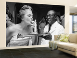 Woman Lighting a Cigarette from a Candle Held by a Waiter at the Piedmont Ball Wall Mural – Large by Paul Schutzer