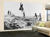 Bushman Children Playing Games on Sand Dunes Wall Mural – Large by Nat Farbman