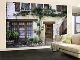 House Facade with Flowers in Lot Valley Wall Mural – Large by Barbara Van Zanten