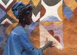 Woman in West Africa Prints by Margaret Courtney-Clarke