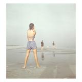 Vogue - December 1946 - Beach Walk Regular Photographic Print by Serge Balkin