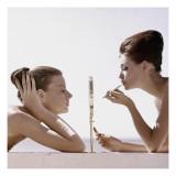 Vogue - April 1960 - Trading Beauty Secrets Regular Photographic Print by  Leombruno-Bodi