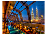 The Sky Bar in Kuala Lumpur with a view of Petronas Premium Photographic Print by Trey Ratcliff