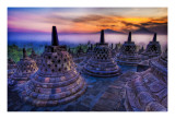 The sunrise as the caged Buddhas look on Premium Photographic Print by Trey Ratcliff