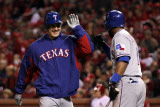 Texas Rangers v St Louis Cardinals, St Louis, MO - Oct. 27: Derek Holland and Elvis Andrus Photographic Print by Ezra Shaw