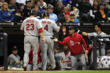 Cardinals v Brewers - Milwaukee, WI - Oct. 16: David Freese, Yadier Molina and Rafael Furcal Photographic Print by Jonathan Daniel