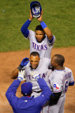 Rangers v Cardinals - Oct. 27: Adrian Beltre, Esteban German, Ron Washington and Elvis Andrus Fotografie-Druck von Dilip Vishwanat