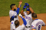 Rangers v Cardinals - Oct. 27: Adrian Beltre, Esteban German, Yorvit Torrealba and Elvis Andrus Photographic Print by Dilip Vishwanat