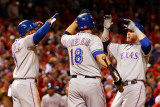 Rangers v Cardinals, St Louis, MO - Oct. 27: Elvis Andrus, Josh Hamilton and Mitch Moreland Photographic Print by Jamie Squire