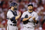 Brewers v St. Louis Cardinals - Oct. 12: Jonathan Lucroy and Yovani Gallardo Photographic Print by Christian Petersen