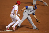 Rangers v Cardinals, St Louis, MO - Oct. 27: Lance Berkman, Colby Lewis and Michael Young Photographic Print by Doug Pensinger