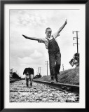 Larry Jim Holm with Dunk, His Spaniel Collie Mix, Walking Rail of Railroad Tracks in Rural Area Framed Photographic Print by Myron Davis