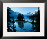 Scenic View of the Lake Surrounded by Evergreens and Snow-Capped Mountains Framed Photographic Print by Raymond Gehman