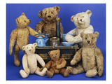 A Selection of Teddy Bears around a Black Painted Tinplate Toy Stove Posters