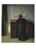 A Lady Writing at Her Desk Print by Vilhelm Hammershoi