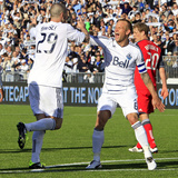 Vancouver, DA March 19 - Eric Hassli and Jay DeMerit Photographic Print by Jeff Vinnick