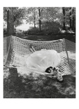Vogue - July 1953 - Lounging in a Ballgown Regular Photographic Print by Gene Moore