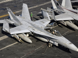 A US Navy F/A-18C Hornet Parked on the Flight Deck of USS Nimitz Photographic Print by  Stocktrek Images