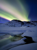 Aurora Borealis over Mikkelfjellet Mountain in Troms County, Norway Photographic Print by  Stocktrek Images