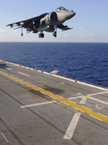 An AV-8B Harrier Jet Prepares to Land on the Flight Deck of USS Essex Photographic Print by  Stocktrek Images