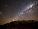 The Milky Way Rising Above the Hills of Azul, Argentina Photographic Print by  Stocktrek Images